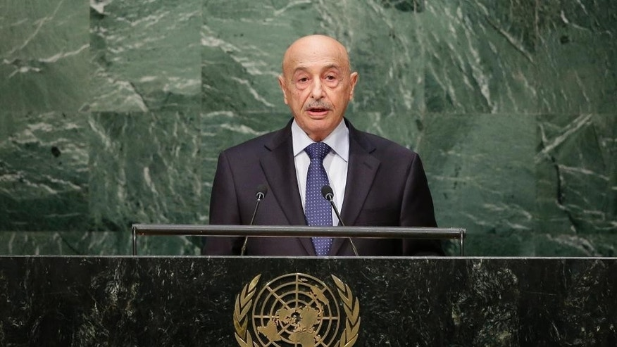 "FILE -- In this Sept. 30, 2015 file photo,  Agila Saleh, then acting head of Libya, speaks during the 70th session of the United Nations General Assembly at U.N. headquarters. Saleh, the head of Libya's internationally-recognized parliament based in the country's far east has criticized Martin Kobler, the U.N. envoy for the North African country, accusing the international community of imposing a unity government that contradicts a U.N.-brokered agreement reached by Libya's rival parties last December. Saleh told Libya 218 television Tuesday, April 12, 2016, that envoy Kobler is acting as Libya's ""ruler"" and paving the way for the unity government to seize power in the capital before parliament votes on it. (AP Photo/Frank Franklin II, File)"