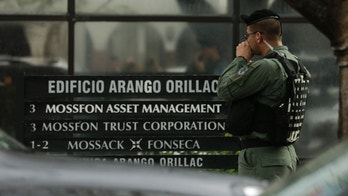 A police officer stands outside Mossack Fonseca law firm while Organized crime prosecutors raid the offices, in Panama City, Tuesday, April 12, 2016. Organized crime prosecutors raided the offices of the Mossack Fonseca law firm looking for evidence of money laundering and financing terrorism following a leak of documents about tax havens it set up for wealthy international clients. (AP Photo/Arnulfo Franco)