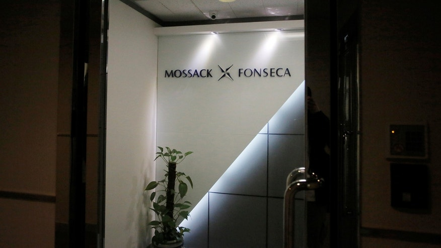 Organized crime prosecutors raided the offices of the Mossack Fonseca law firm Tuesday looking for evidence of money laundering and financing terrorism following a leak of documents about tax havens it set up for wealthy international clients. (AP Photo/Arnulfo Franco)