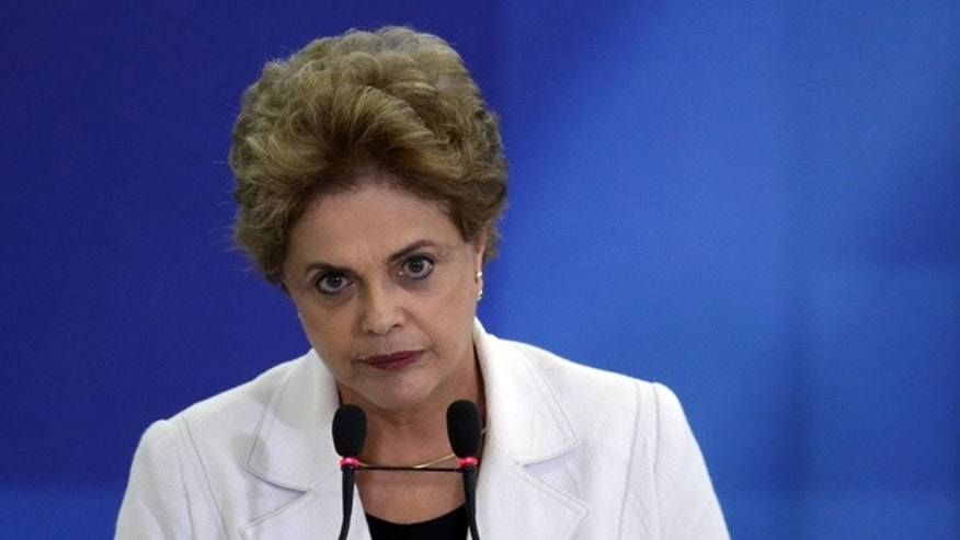 Brazil's President Dilma Rousseff pauses as she addresses teachers and students during a ceremony at Planalto presidential palace in Brasilia, Brazil, Tuesday, April 12, 2016. Rousseff on Tuesday called her Vice President Michel Temer the âhead of the conspiracyâ that seeks to remove her from office in her most direct attack on him so far. (AP Photo/Eraldo Peres)