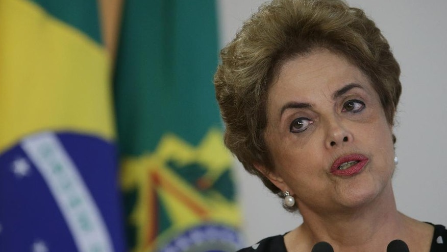 Brazil's President Dilma Rousseff speaks during a meeting at the Planalto Presidential Palace, in Brasilia, Brazil, Wednesday, April 13, 2016. President Rousseff is facing impeachment proceedings that stem from allegations her administration violated fiscal rules to mask budget problems by shifting around government accounts. (AP Photo/Eraldo Peres)