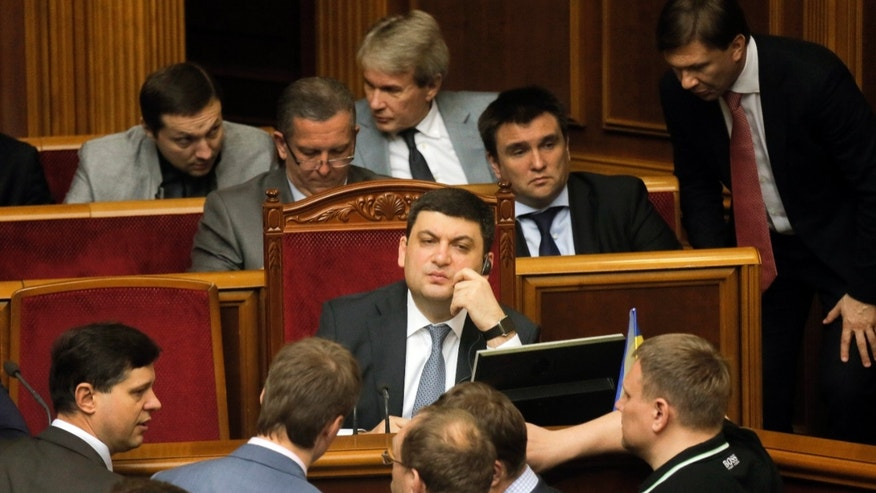 Vladimir Groysman, center, speaks with lawmakers after he was appointed Prime Minister.