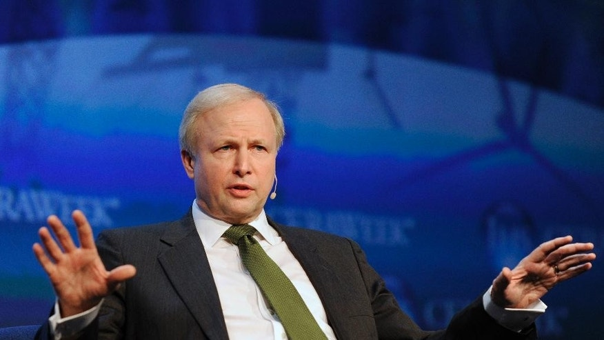 FILE- In this March 6, 2013 file photo, BP Group Chief Executive Bob Dudley gestures as he speaks at the IHS CERAWEEK energy conference in Houston. BP said Thursday, April 14, 2016,  it's ready to listen to shareholder concerns about its executive compensation policy after some of the company's largest shareholders opposed plans to boost CEO Bob Dudley's pay package by 20 percent to $19.6 million even after earnings plunged. (AP Photo/Pat Sullivan, File)