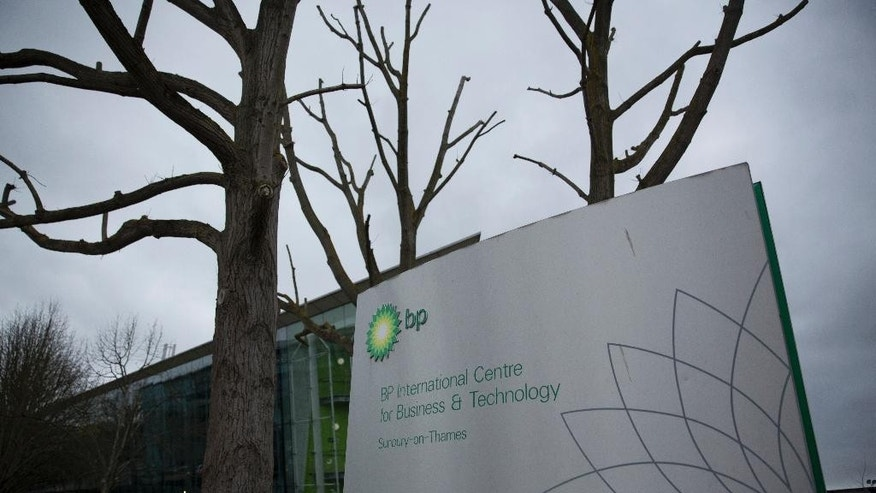 FILE- In this Feb. 2, 2016 file photo, a sign stands outside the BP International Centre for Business and Technology in Sunbury-on-Thames, south west London. BP says it's ready to listen to shareholder concerns about its executive compensation policy after some of the company's largest shareholders opposed plans to boost CEO Bob Dudley's pay package by 20 percent to $19.6 million even after earnings plunged. (AP Photo/Matt Dunham, File)