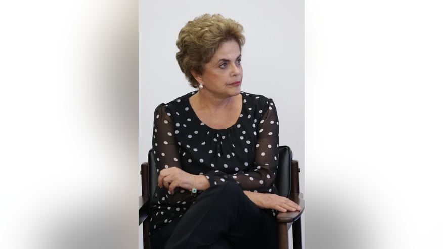 Brazil's President Dilma Rousseff listems in during a meeting at the Planalto Presidential Palace, in Brasilia, Brazil, Wednesday, April 13, 2016. President Rousseff is facing impeachment proceedings that stem from allegations her administration violated fiscal rules to mask budget problems by shifting around government accounts. (AP Photo/Eraldo Peres)