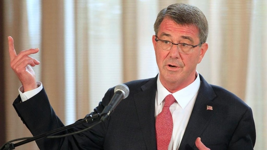 U.S. Defense Secretary Ash Carter gestures during a joint press conference at the Malacanang presidential palace in Manila, Philippines on Thursday, April 14, 2016. The United States on Thursday revealed for the first time that American ships have started conducting joint patrols with the Philippines in the South China Sea, a somewhat rare move not done with many other partners in the region. (Romeo Ranoco/Pool Photo via AP)