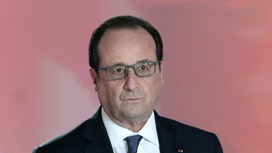 French President Francois Hollande poses prior to a debate on national television in Paris, France, Thursday, April 14, 2016. French President Francois Hollande answers questions on national television from members of the public, as the unpopular president faces labor protests and questions about whether he'll run for re-election. (Stephane de Sakutin, Pool Photo via AP)