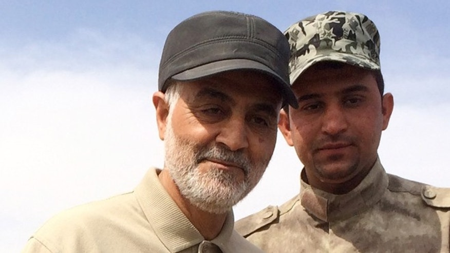 Gen. Qassem Soleimani, left, on the front lines of anti-ISIS fighting in March 2015 in Iraq.