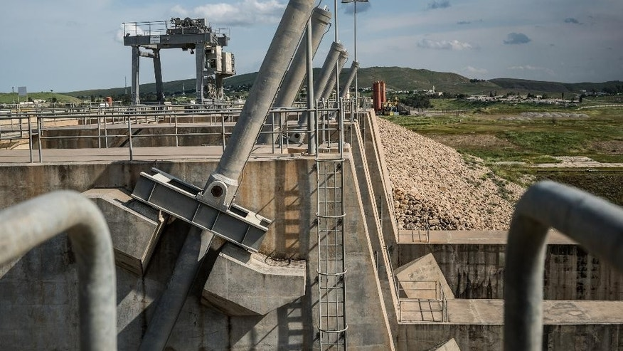 View of the valves used to open the spillway gate at the Mosul Dam in northern Iraq on Thursday, April 14, 2016. A team of Italian specialists arrived Thursday at the site of the Mosul Dam as part of an emergency campaign to repair Iraq's largest dam before it collapses.(AP Photo/Alice Martins)