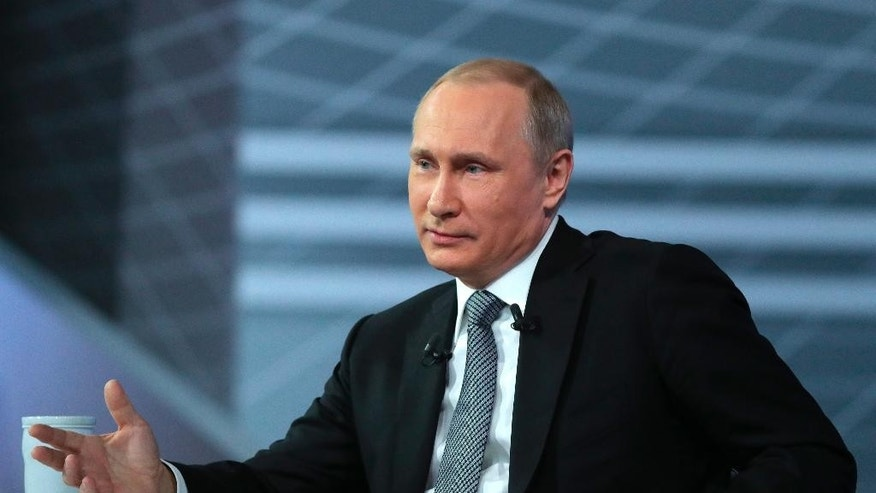 Russian President Vladimir Putin gestures while speaking during his annual call-in show in Moscow, Russia, Thursday, April 14, 2016. The Kremlin has been sifting through more than 1 million questions from across the country to get Putin ready for the television marathon. (Mikhail Klimentyev/Sputnik, Kremlin Pool Photo via AP)