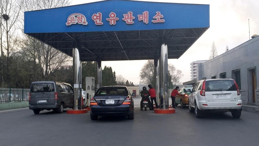 In this April 1, 2016 photo, cars line up at the pumps at a gas station in Pyongyang, North Korea. Gas stations have been springing up all over Pyongyang over the past few years, reflecting a major increase in traffic. But with gas prices going up, drivers in Pyongyang are starting to feel some pain at the pump, which might not be good news for the isolated country's shifting domestic economy. (AP Photo/Eric Talmadge)