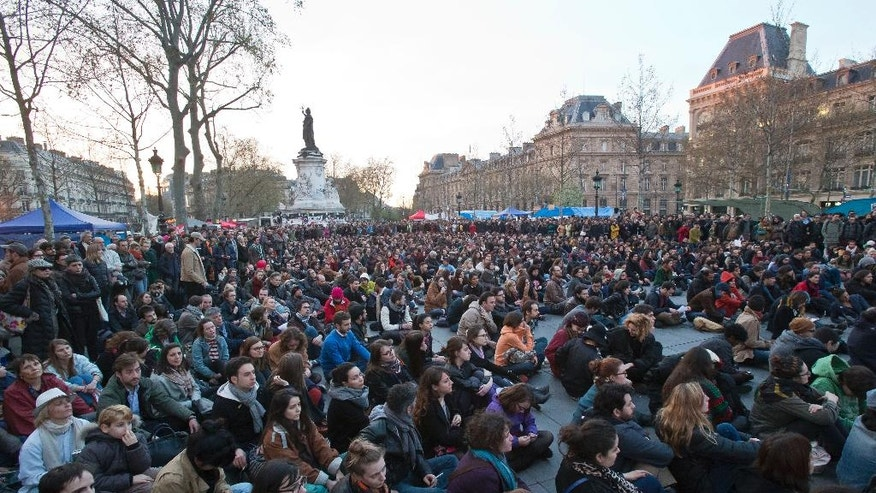 "People gather on the Place de la Republique, in Paris, France, Wednesday, April 13, 2016. Thousands of protesters have been camping out, holding night-time demonstrations at a symbolic rallying point on the Place de la Republique, to express anger at a proposed labor law and social conditions in France. The social media-driven movement, called ""Nuit Debout"" or ""Rise up at Night,"" sprang from nationwide strikes and protests. (AP Photo/Michel Euler)"