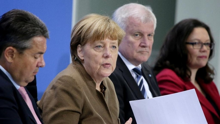 From left, Sigmar Gabriel, Chairman of the German Social Democrats, German Chancellor Angela Merkel, Horst Seehofer, Chairman of the German Christian Social Union and German Labor Minister Andrea Nahles address the media during a press conference in Berlin, Germany, Thursday, April 14, 2016 on the results of a meeting of the heads of the German government coalition. (AP Photo/Michael Sohn)