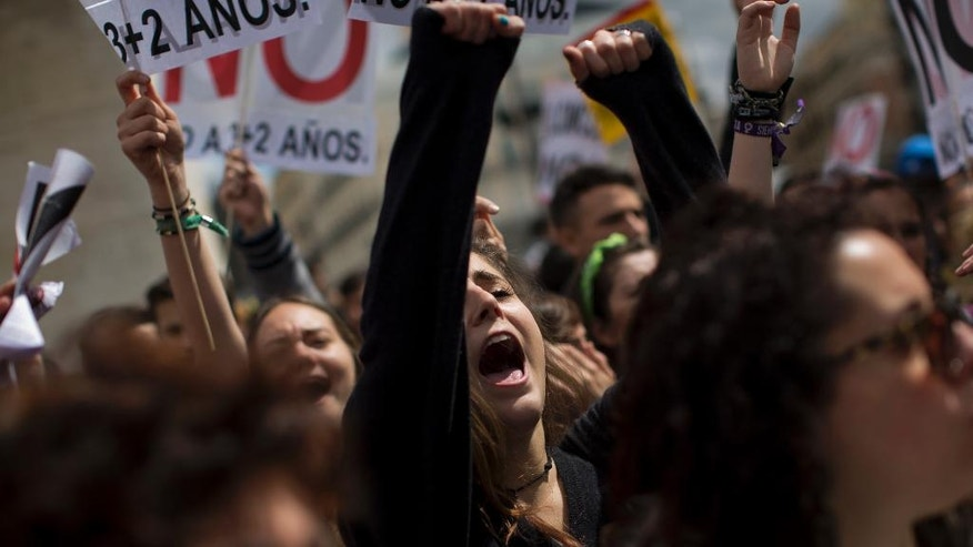 Students shout slogans against the Spanish government during a demonstration in Madrid, Spain, Thursday, April 14, 2016. Thousands of university students opposed to increased costs for higher education programs, took part in different protests in Madrid and Barcelona. (AP Photo/Emilio Morenatti)