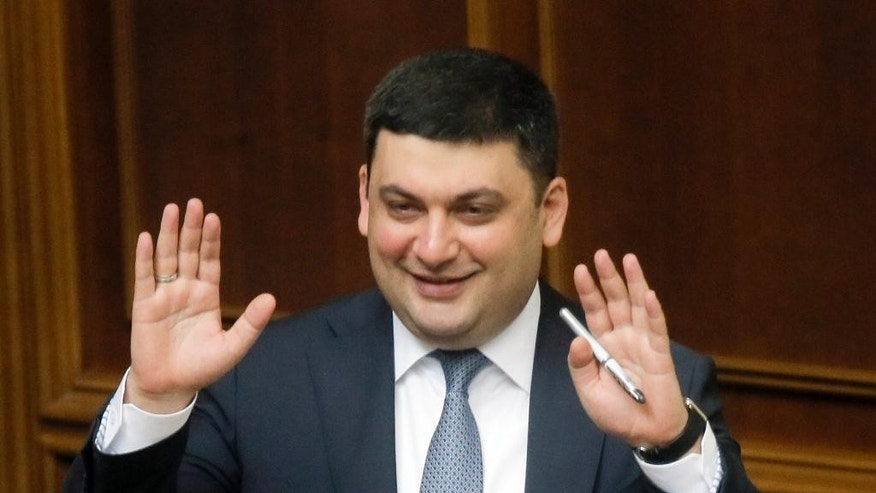 Ukraine's Prime Minister Vladimir Groysman smiles after he was appointed the Prime Minister during the Ukrainian parliament session in Kiev, Ukraine, Thursday, April 14, 2016. Ukraine's parliament has endorsed Arseniy Yatsenyuk's resignation and appointed Vladimir Groysman as the new prime minister. (AP Photo/Efrem Lukatsky)