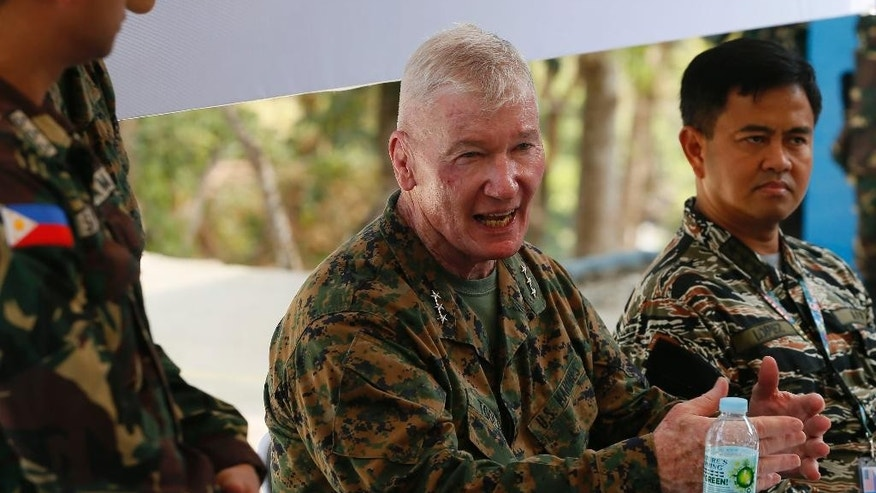 "Lt. Gen. John Toolan, center, Commander of US Marine Corps in the Pacific, gestures while answering questions following the 11-day joint US-Philippines military exercise dubbed ""Balikatan 2016"" (Shoulder-To-Shoulder 2016) Thursday, April 14, 2016 at Crow Valley, Tarlac province north of Manila, Philippines. U.S. Defense Secretary Ash Carter arrived in the country Wednesday for talks with President Benigno Aquino III and other top defense and military officials and to visit two military camps being utilized for the exercise. Looking at right is Philippine Vice-Admiral Alexander Lopez.(AP Photo/Bullit Marquez)"