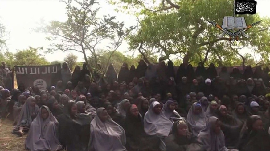 In this file photo taken from video released by Nigeria's Boko Haram terrorist network, Monday May 12, 2014, shows missing girls abducted from the northeastern town of Chibok.