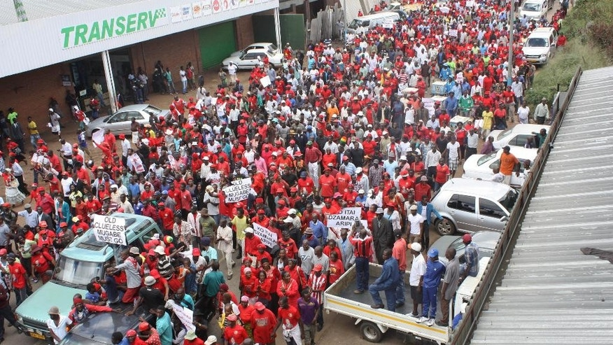 Opposition party supporters march during a protest aimed at President Robert Mugabe in Harare, Zimbabwe, Thursday, March, 14, 2016. Morgan Tsvangirai, one of the main opposition supporters, addressed the demostrators and called on the government to take action in addressing the issues ordinary Zimbabweans are facing. (AP Photo/Tsvangirayi Mukwazhi)