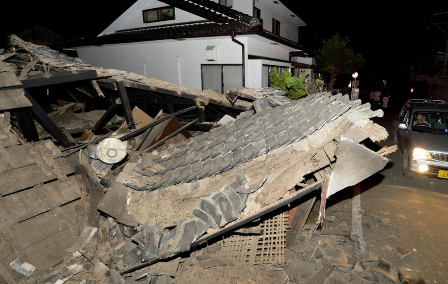 A roof collapses following the earthquake in Mashiki, near Kumamoto city, southern Japan,  early Friday, April 15, 2016.  Rescuers in southern Japan are searching for trapped residents in at least two dozen collapsed houses, after a powerful earthquake struck. (Tomoaki Ito/Kyodo News via AP) JAPAN OUT, MANDATORY CREDIT