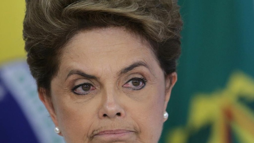 Brazil's President Dilma Rousseff attends a meeting on state land issues, at Planalto presidential palace in Brasilia, Brazil, Friday, April 15, 2016. The lower chamber of Brazil's Congress began a debate on whether to impeach Rousseff, a question that underscores deep polarization in Latin America's largest country and most powerful economy. The crucial vote is slated for Sunday. (AP Photo/Eraldo Peres)