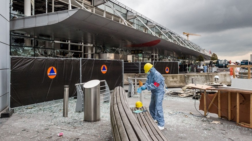 March 23, 2016: A forensics officer works in front of the damaged Zaventem Airport terminal in Brussels.