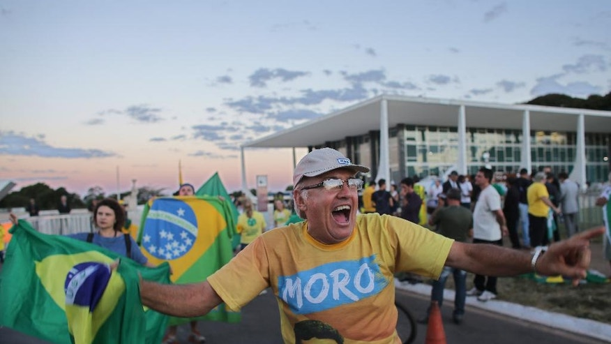 "A demonstrator shouts slogans in support of the impeachment of Brazil's President Dilma Rousseff, in front of the Supreme Court, in Brasilia, Brazil, Thursday, April 14, 2016. Brazil's top court said it would soon rule on President Dilma Rousseff's motion to annul the upcoming impeachment vote against her, a process that the top legal official in her government said had been ""contaminated."" (AP Photo/Eraldo Peres)"