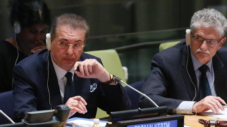 Former Macedonian Foreign Minister Srgjan Kerim, left, is seated next to General Assembly President Mogens Lykketoft, right, while listening to questions from U.N. General Assembly members about his candidacy for U.N. Secretary General, Thursday April 14, 2016 at U.N. headquarters. The United Nations is taking a historic step to open up the usually secret process of selecting the next secretary-general, giving all countries the chance to question candidates on issues. (AP Photo/Bebeto Matthews)