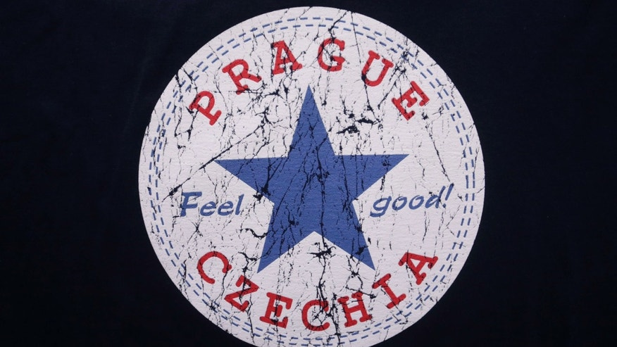 "April 14, 2016: A sign with the word ""Czechia"" is printed on a t-shirt displayed in a store in Prague, Czech Republic."