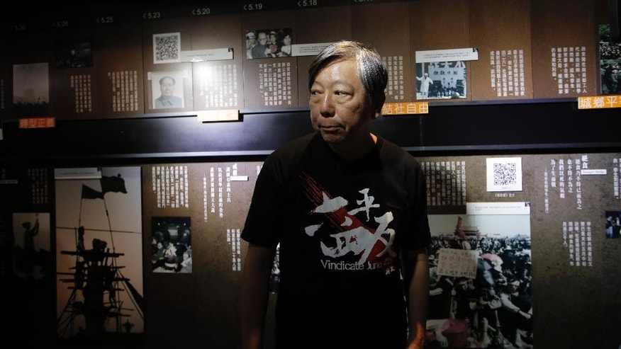 Lee Cheuk-yan, Secretary of Hong Kong Alliance in Support of Patriotic Democratic Movements in China, speaks to a reporter at the June 4th Museum in Hong Kong, Friday, April 15, 2016. The operators of the world's only museum chronicling the Chinese government's brutal 1989 crackdown on student protesters in Beijing's Tiananmen Square say it faces closure because of a legal dispute. (AP Photo/Kin Cheung)