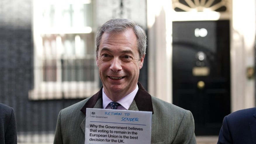 Nigel Farage, the leader of the UK Independence Party, poses for the media as he returns and rejects a government mailshot leaflet stating their reasons for the UK to stay in the EU outside the door of 10 Downing Street in London, Friday, April 15, 2016. Britain is to hold a referendum on their EU membership on June 23. (AP Photo/Matt Dunham)