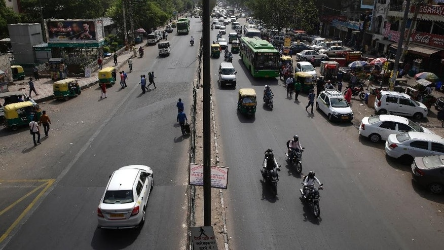 Few vehicles are seen plying on the otherwise severely busy Mehrauli Badarpur road during rush hour in New Delhi, India, Friday, April 15, 2016. The New Delhi government has begun a second round of a two-week car restriction whereby private cars will be allowed on the streets on alternate days from Friday until April 30 based on even or odd license plate numbers, to reduce air pollution that has made the Indian capital the world's most polluted city. (AP Photo/Saurabh Das)