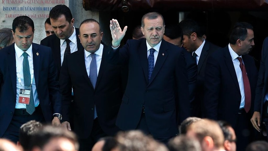Turkey's President Recep Tayyip Erdogan  waves as he leaves Bezm-i Alem Valide Sultan Mosque after Friday prayers during the 13th Organization of Islamic Cooperation, OIC, Summit in Istanbul, Friday, April 15, 2016. Muslim nations have agreed to establish a joint body based in Istanbul to fight terrorism.(AP Photo/Emrah Gurel)