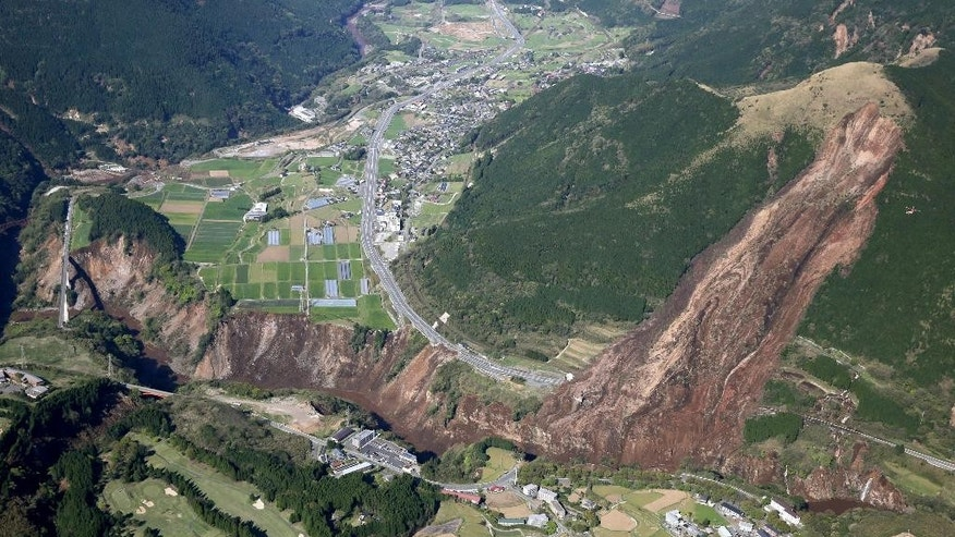A landslide is seen after the earthquake in Minamiaso, Kumamoto prefecture, southern Japan Saturday, April 16, 2016. A powerful earthquake struck southern Japan early Saturday, barely 24 hours after a smaller quake hit the same region. (Kyodo News via AP) JAPAN OUT, MANDATORY CREDIT