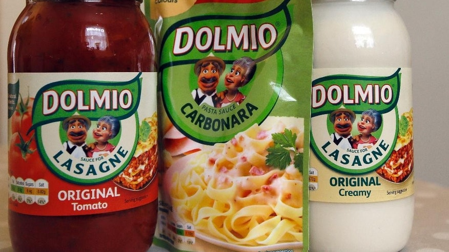Dolmio pasta sauces are photographed in London, Friday, April 15, 2016. Mars Food, the maker of Dolmio and Uncle Ben's, says some of its pasta sauces will soon carry labeling suggesting they should only be an occasional treat due to high content of sugar, salt or fat. (AP Photo/Kirsty Wigglesworth)