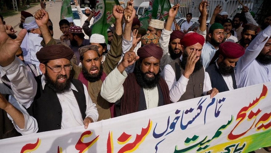 "Activists of Pakistani religious group Sunni Tehreek demanding executions of court sentences given under the blasphemy law, during a protest in Rawalpindi, Pakistan, Friday, April 15, 2016. Banner reads ""court sentences awarded to all blasphemers including Asia, should be implemented. "" Asia Bibi, a Christian woman sentenced for death for blasphemy. (AP Photo/B.K. Bangash)"