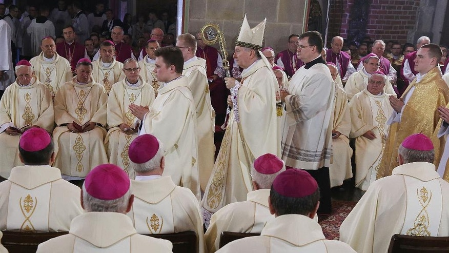 The Vatican Secretary of State, Cardinal Pietro Parolin, center, presides a Mass, as part of Poland's celebration of 1,050 years of the nation's Catholicism at the 10th-century cathedral in Gniezno, in western Poland, Thursday, 14 April 2016. Poland's bishops on Thursday opened religious and political celebrations that mark 1,050 years of Christianity in Poland with a debate on its significance for the nation.  The church and the conservative government jointly organized the three-day ceremonies that opened Thursday in the western town of Gniezno, considered to be the cradle of Poland's Catholicism.  (AP Photo/Czarek Sokolowski)