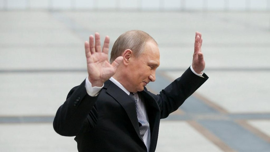 "Russian President Vladimir Putin gestures after speaking to the media after his marathon call-in TV show in Moscow, Russia, on Thursday, April 14, 2016. Russian President Vladimir Putin says the United States must abandon its ""imperial ambitions"" and treat Russia as an equal partner. (AP Photo/Alexander Zemlianichenko)"
