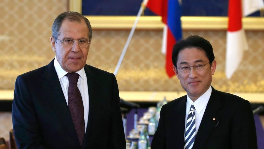 Russia's Foreign Minister Sergey Lavrov, left, and his Japanese counterpart Fumio Kishida shake hands for their meeting at the foreign ministry's Iikura guest house in Tokyo, Japan, Friday, April 15, 2016. (Toru Hanai/Pool Photo via AP)