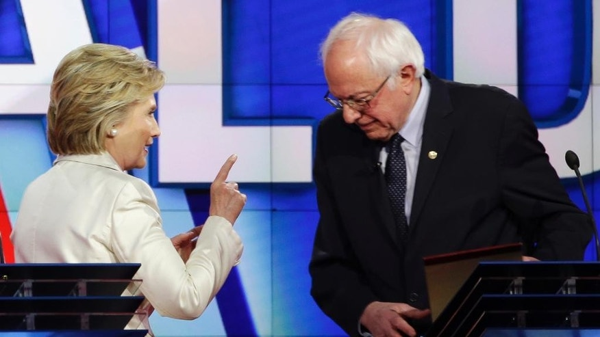 Democratic presidential candidate Hillary Clinton, left, gestures towards Democratic presidential candidate Sen. Bernie Sanders, I-Vt., at the start of a break during the CNN Democratic Presidential Primary Debate at the Brooklyn Navy Yard on Thursday, April 14, 2016 in New York. (AP Photo/Seth Wenig)