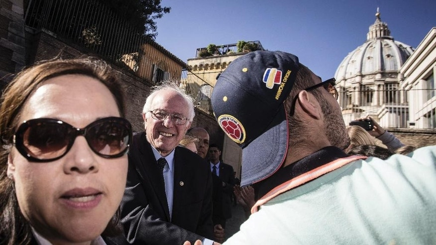 "US presidential candidate Bernie Sanders meets supporters outside the Perugino gate at the Vatican, Friday, April 15, 2016. Sanders spoke at a conference commemorating the 25th anniversary of ""Centesimus Annus,"" a high-level teaching document by Pope John Paul II on the economy and social justice at the end of the Cold War. (Angelo Carconi/ANSA via AP)"