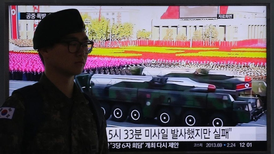 "A South Korean army soldier passes by a TV news program showing a file footage of North Korean missiles on a military parade at Seoul Railway Station in Seoul, South Korea, Friday, April 15, 2016. A North Korean launch of a missile on the birthday of its revered founder appears to have failed, South Korean and U.S. defense officials said Friday. The letters on a screen read: ""North Korean launch of a missile appears to have failed."" (AP Photo/Ahn Young-joon)."