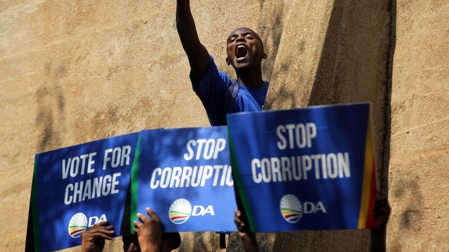 An opposition Democratic Alliance (DA) supporter voices his support after a protest march to the Constitutional Court in Johannesburg Friday, April 15, 2016. The march follows a recent Constitutional Court judgment that President Jacob Zuma failed to uphold the Constitution when he did not comply with Public Protector Thuli Madonsela's remedial action regarding payments for the non-security upgrades to his private residence. (AP Photo/Denis Farrell)
