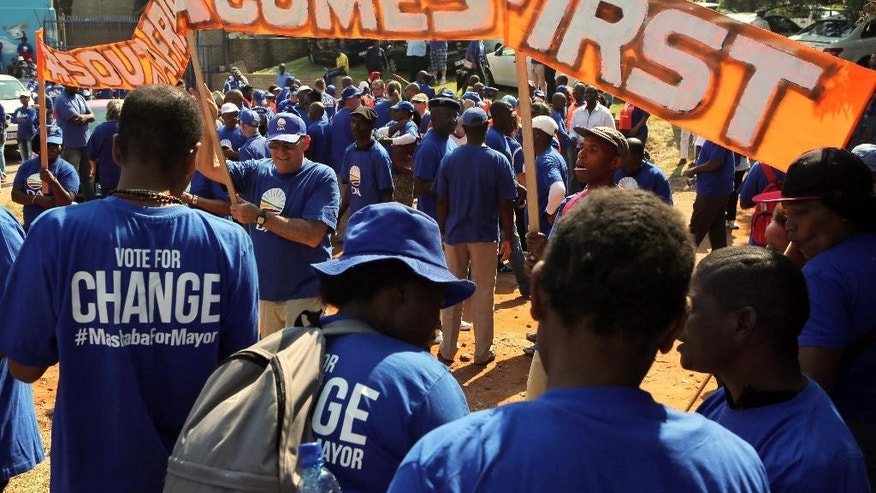 Opposition Democratic Alliance (DA) supporters prepare to march to the Constitutional Court in Johannesburg, Friday, April 15, 2016. The march follows a recent Constitutional Court judgment that President Jacob Zuma failed to uphold the Constitution when he did not comply with Public Protector Thuli Madonsela's remedial action regarding payments for the non-security upgrades to his private residence. (AP Photo/Denis Farrell)