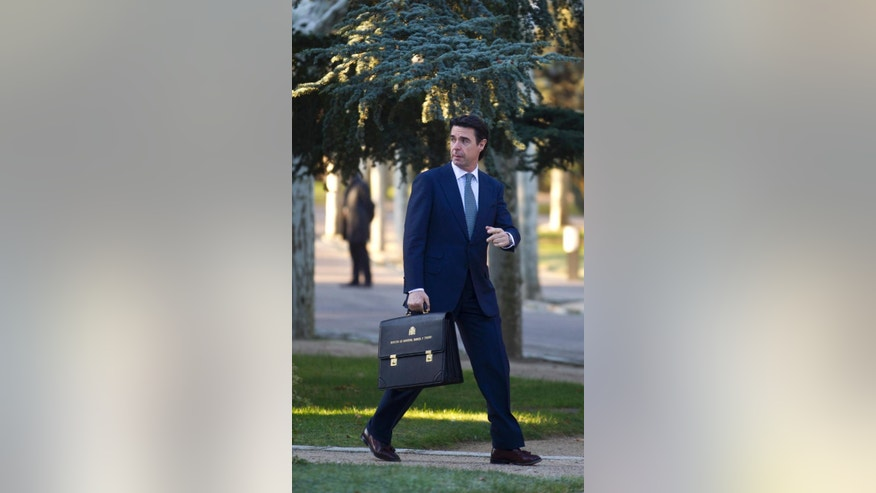 FILE, In this Friday Dec. 23, 2011 file photo, Spain's Energy and Tourism Minister Jose Manuel Soria arrives at the Moncloa Palace in Madrid. Spain's acting industry minister, who has been linked to offshore companies, resigns. (AP Photo/Paul White, File)