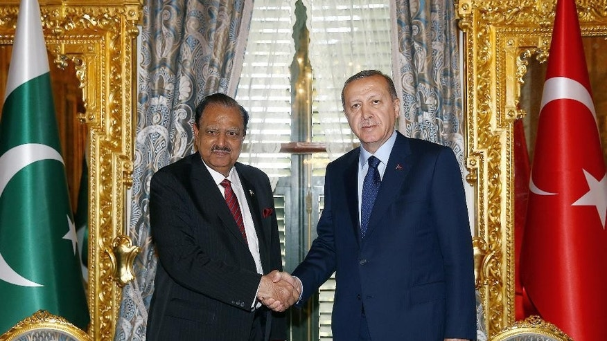 Turkish President Recep Tayyip Erdogan, right, and Pakistan President Mamnoon Hussain shake hands before a meeting in Istanbul, Wednesday, April 13, 2016. Hussain is in Turkey for the meetings of Organization of Islamic Cooperation, OIC, on Thursday and Friday.(Presidential Press Service/Pool Photo via AP )