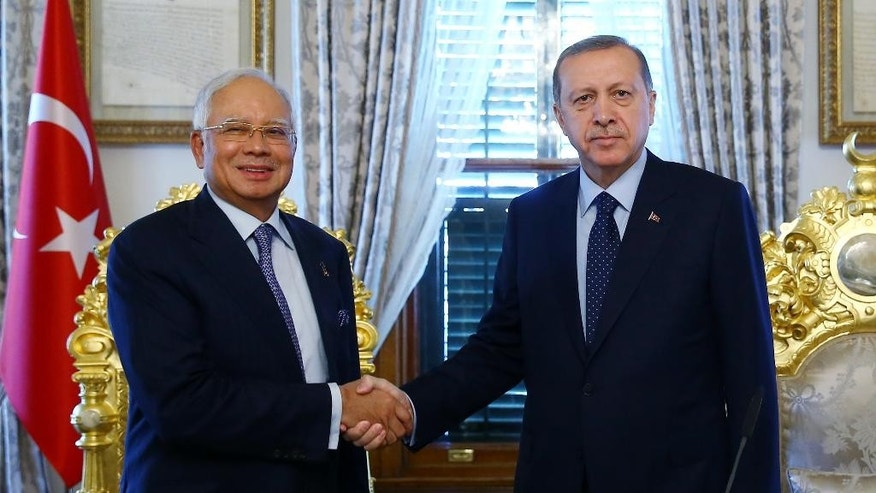 Turkish President Recep Tayyip Erdogan, right, and Malaysian Prime Minister Najib Razak shake hands before a meeting in Istanbul, Wednesday, April 12, 2016. Razak is in Turkey for the meetings of Organization of Islamic Cooperation, OIC, on Thursday and Friday.(Presidential Press Service/Pool Photo via AP )