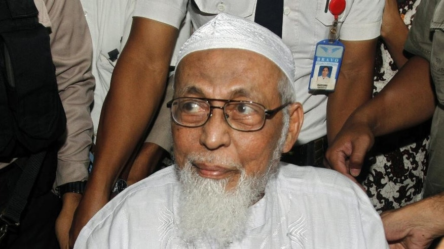 "FILE - In this Wednesday, Feb. 29, 2012 file photo, Indonesian militant cleric Abu Bakar Bashir arrives at a hospital to undergo medical treatment, in Jakarta, Indonesia. A lawyer for the spiritual leader of the militants who carried out the 2002 Bali bombings urges Indonesian authorities to end his ""inhumane"" treatment in prison, saying that Bashir has been confined to a tiny isolation cell in the wake of the Jan. 14 suicide bombings in the Indonesian capital Jakarta. (AP Photo/Tatan Syuflana, File)"