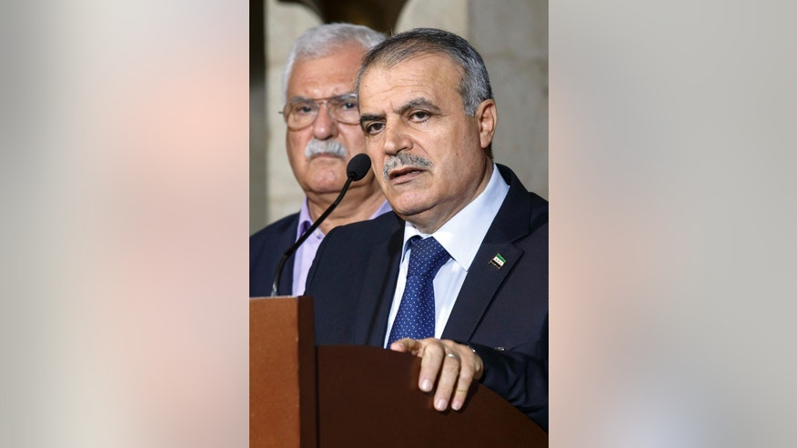 Asaad Al-Zoubi, right, head of the Syrian opposition delegation of High Negotiations Committee (HNC), speaks to the media next to George Sabra, left, Syrian opposition Deputy Head of High Negotiations Committee (HNC), during a briefing after a round of negotiation between the Syrian government and the UN Special Envoy of the Secretary-General for Syria Staffan de Mistura, at the European headquarters of the United Nations in Geneva, Switzerland, Friday, April 15, 2016. (Salvatore Di Nolfi/Keystone via AP)