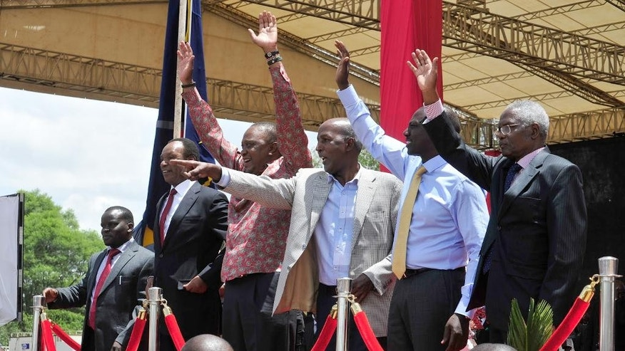 From left to right, Joshua Arap Sang, Henry Kosgei, President Uhuru Kenyatta, Major Gen. Hussein Ali, Kenyan Vice president William Ruto, and Ambassador Francis Muthaura, gesture,  as they attend a thanks giving rally, in Nakuru, Kenya,  Saturday, April 16, 2016. Kenyan President Uhuru Kenyatta and five others who had been charged with crimes against humanity at the International Criminal Court held a rally attended by thousands to celebrate the withdrawal of the charges against them. The rally has been opposed by opposition leader Raila Odinga and some members of civic organizations who say it does not respect the suffering of the victims of violence following a disputed presidential election late 2007. (AP Photo/Kevin Midigo)