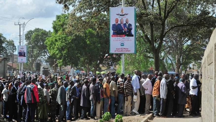 Hundreds of Kenyans line up to get into the Afraha Stadium, Nakuru, Kenya to attend a thanks giving rally, Saturday, April 16, 2016. Kenyan President Uhuru Kenyatta and five others who had been charged with crimes against humanity at the International Criminal Court held a rally attended by thousands to celebrate the withdrawal of the charges against them. The rally has been opposed by opposition leader Raila Odinga and some members of civic organizations who say it does not respect the suffering of the victims of violence following a disputed presidential election late 2007. (AP Photo/Kevin Midigo)